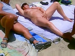 Two men masturbating to nude mature woman