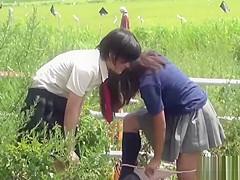 Teens peeing in field