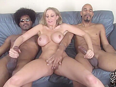 Busty blonde cougar, Julia Ann likes to have sex with two black guys at the same time