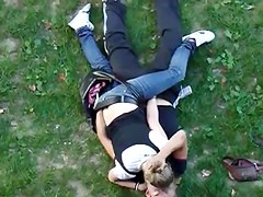 Young couple having sex in public park